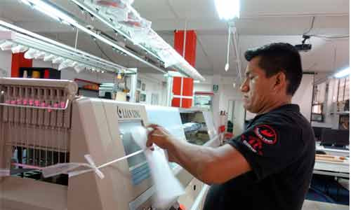 Maquina tejedora computarizada